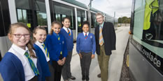 Councillor Alan Clark and girls from Whitemoor Academy naming a tram