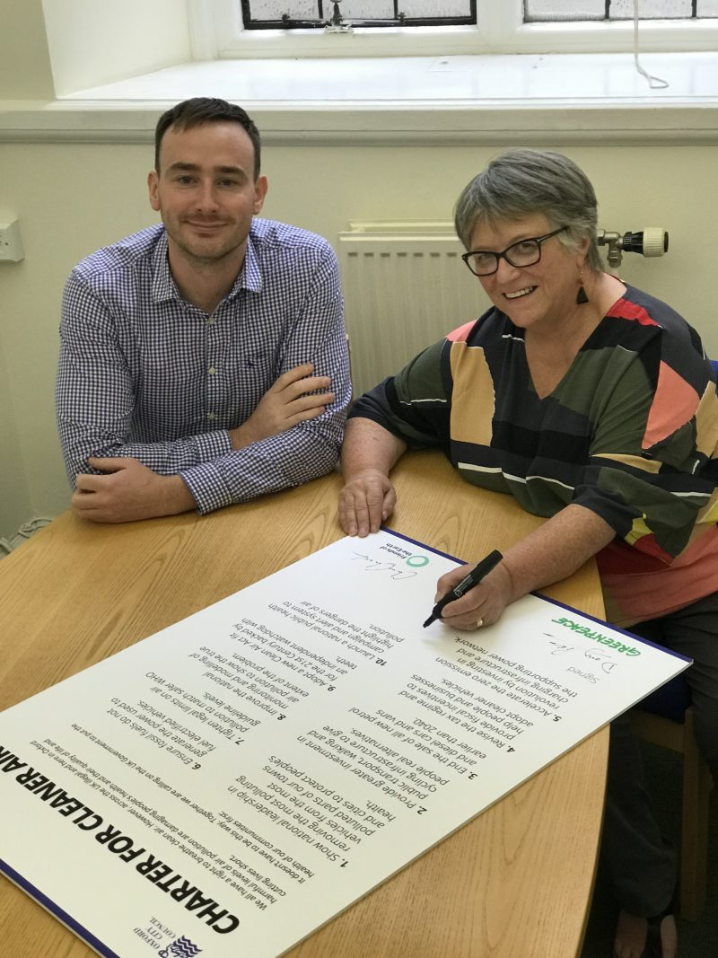 Councillor Sally Longford, Portfolio Holder for Energy and Environment at Nottingham City Council, signs the Charter for Cleaner Air with Councillor Tom Hayes, Board Member for Safer, Greener, Environment at Oxford City Council