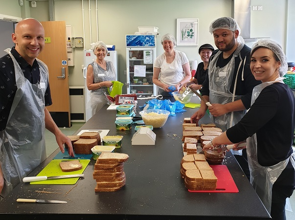 Volunteers make sandwiches in Clifton