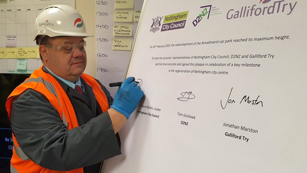 Councillor David Mellen signs what will become a commemorative plaque for the new Broadmarsh Car Park