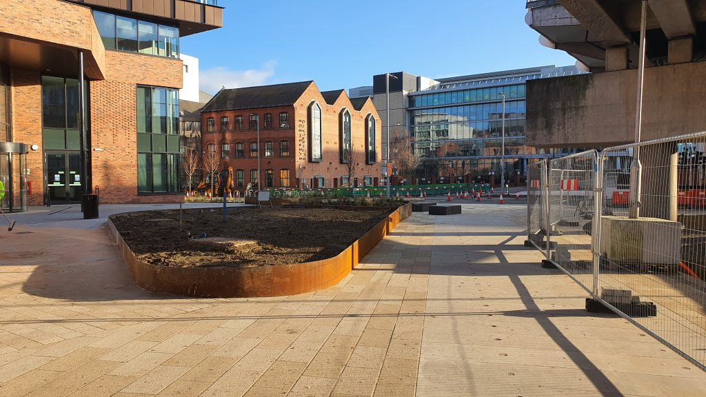 New public realm at Sussex Street, under the tram viaduct