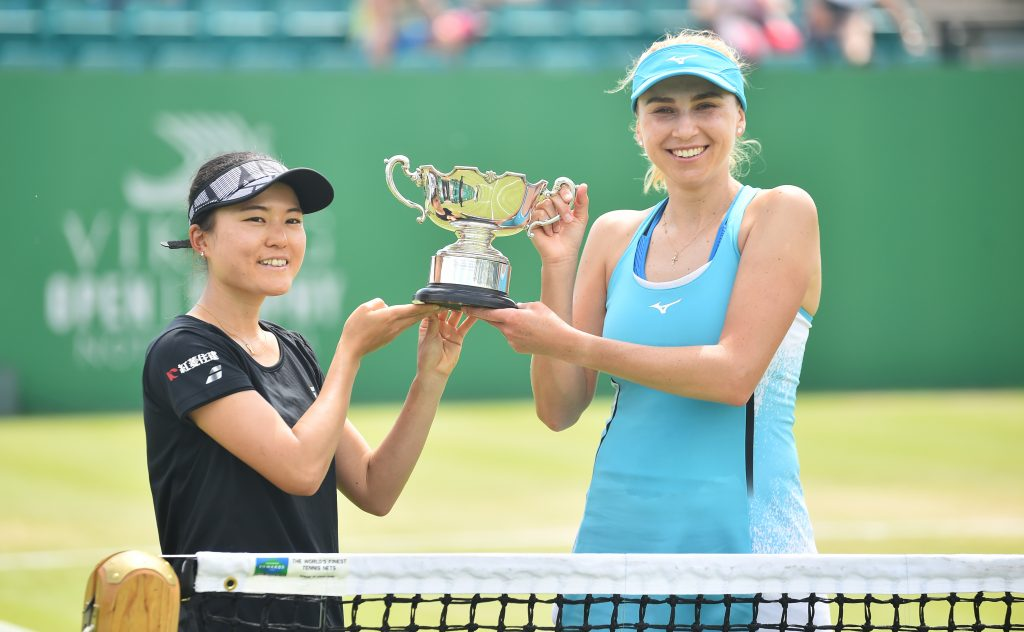 NOTTINGHAM, ENGLAND - JUNE 13: Makoto Ninomya of Japan and Lyudmyla Kichenok of Ukraine hold the Viking Open Trophy after they win the women's doubles final between Caroline Dolehide and Storm Sanders at Nottingham Tennis Centre on June 13, 2021 in Nottingham, England. (Photo by Nathan Stirk/Getty Images for LTA)